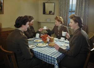 Auxiliary_Terrotorial_Service_have_tea_during_a_domestic_science_course_for_service_women_at_Avondale_Park_School,_Notting_Hill_Gate,_London,_1945._TR2606[1]