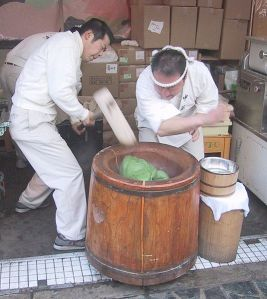 Two Japanese men pounding rice cakes.