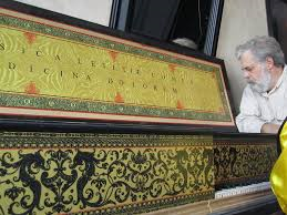 """Tim Jenison examines the harpsichord he built for his experiment with the camera obscura and Vermeer's painting, """"The Music Lesson"""""""
