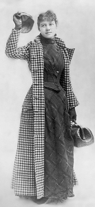Newspaperwoman Nellie Bly in her famous check dress, ready to embark around the world.