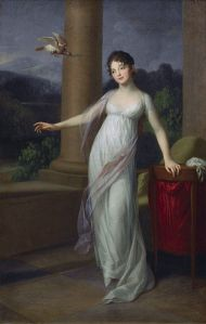 White dress with lavender scarf . . . right? (Or is it a gray dress with a pink scarf? Or a blue dress with purple scarf? Or . . . ?) Via Wikimedia Commons