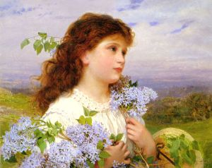 Girl holding lilacs outdoors.