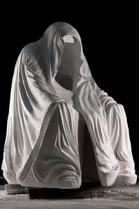 White, cold marble cloak hanging over an invisible figure. You can go inside, as if the cloak draped you. Much spookiness.