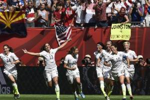 U.S. women's team celebrates a goal in the championship game July 5, 2015. Copyright 2015 Agence France-Presse/Getty Images