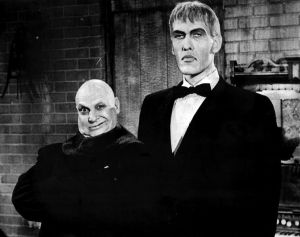 Uncle Fester and Butler Lurch posing stiffly in a 1966 TV show PR photo.