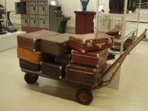 a cart piled high with nine old leather suitcases