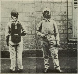two people in pressure suits showing oxygen tanks.