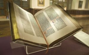 "The ""Lenox Copy"" of the Gutenberg Bible, New York Public Library. By NYC Wanderer (Kevin Eng) - originally posted to Flickr as Gutenberg Bible, CC BY-SA 2.0, https://commons.wikimedia.org/w/index.php?curid=9914015"
