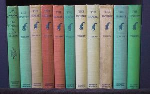 A rainbow row of second edition Hobbits from 1937. If you could smell them, they'd smell like well-loved old books.