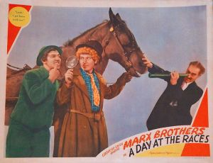 Chico, Harpo and Groucho Marx with a horse for a movie advertisement of A Day at the Races.
