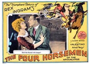 Lobby Card for a 1921 movie with a man embracing a reluctant woman, and four cartoon horsemen of the apocalypse riding their way around the corner.