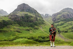 A Bagpiper stands at Coire nan Lochan. Photo by DAVID ILIFF. License: CC-BY-SA 3.0