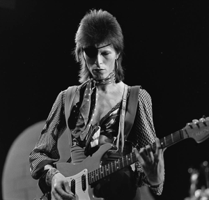 1974 David Bowie playing guitar with his hair in that fuzzy mullet.