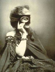 A countess in a cape hiding behind a piece of cardboard that only shows her eye.