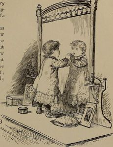 A baby looking into the mirror, much like a famous picture of Alice kneeling on the mantlepiece looking into Wonderland.