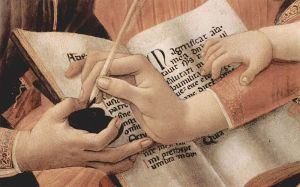 Woman's hand with quill pen and ink, with baby's hand on her forearm.