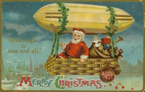 "Christmas postcard with Santa Claus and bag of toys in a basket suspended by greenery from an airship, with ""Greetings to one and all - Merry Christmas."" Color postcard, ca. 1916. Missouri History Museum Photographs and Prints Collections. N39376."