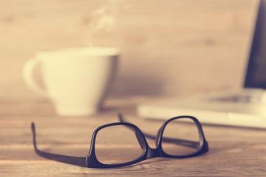 eyeglasses and desk