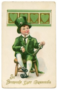 A darling boy dressed as a leprechaun with a top hat, knee breeches and buckled shoes
