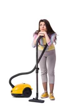 59612318 - woman with vacuum cleaner isolated on white