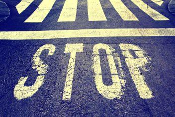 44725499 - vintage stop sign on city asphalt floor.
