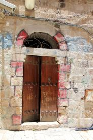 20817926 - vintage wooden door in the old part of jerusalem