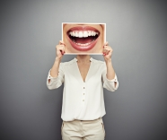 woman holding picture with big smile