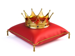 Gold crown on red pillow