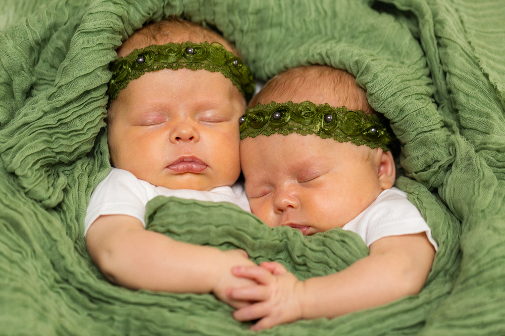 Identical Twin Babies in Green Blankets