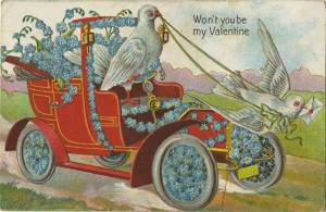 Doves driving an old-fashioned automobile bedecked with flowers (one dove has a letter in her mouth)