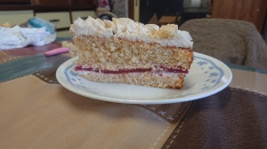 Homemade white cake with strawberry and whipped cream filling really nice crumb