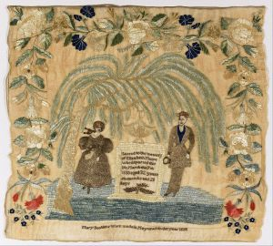 Mourning sampler with a man and woman under a weeping willow tree; other flowers.