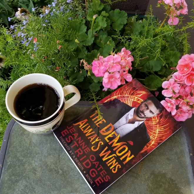 Book 1 with pink geraniums and coffee