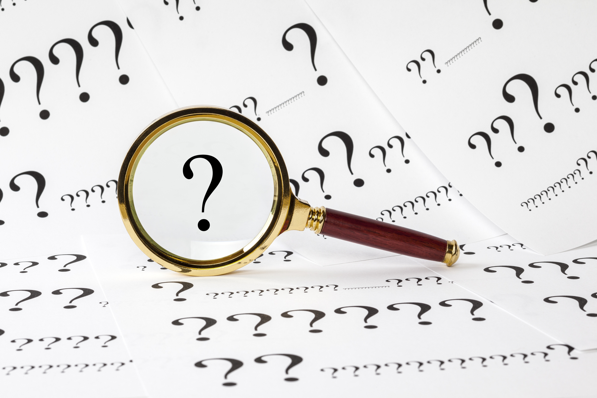 Question Concept with Magnifying Glass