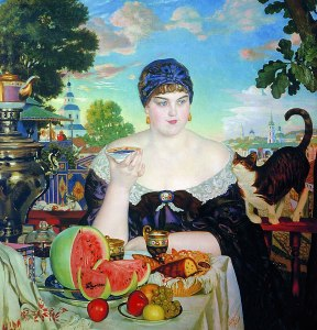A large young woman holding a saucer of tea. On the table is a samovar, watermelon, fruitcake, apples and grapes. Next to her, a cute kitty rubs her shoulder. Affluent and full of sunshine.