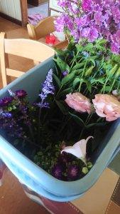 rectangular bucket full of flowers