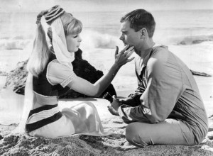 Still from *I Dream of Jeannie*. Jeannie caresses Tony's face during their first meeting on a desert island.