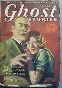 August 1928 cover of Ghost Stories magazine. Fully dressed white lovers from the 1920s with expressions of fear on their faces. The man is holding the woman, and she cuddles up to his chest.