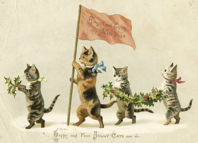 Four kittens marching through the snow on hind legs, with ribbons around their necks, holly in their front paws. Flag by biggest cat reads: Bright and happy thy New Year. Caption is Happy and Free Jolly Cats are we.