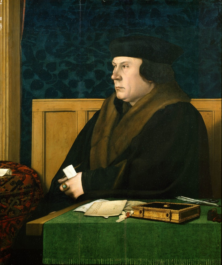 Thomas Cromwell sitting at a table covered with a beautiful green fabric. A book is by his side, with writing quill, letters, and broken seals.